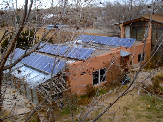 Passive and active solar retrofit on a traditional adobe for Adobe roof